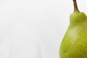Fresh pear on a white wooden