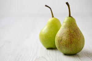 Fresh pears on a white wooden