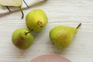Fresh pears on white wooden