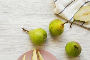 Fresh sweet pears on white wooden
