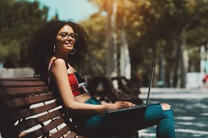 Girl in glasses with the laptop
