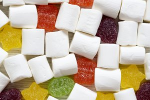 Candy on a white wooden table