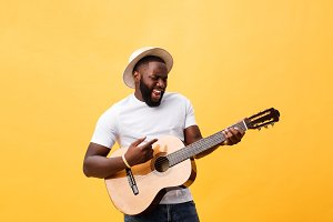 Muscular black man playing guitar