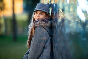 Photo of girl in gray hat and coat