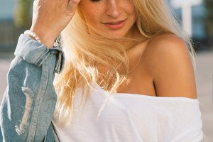 Portrait of young blonde woman on