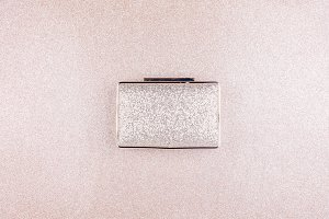 Golden evening clutch on glitter