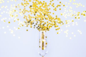Champagne glass bursting with sprink