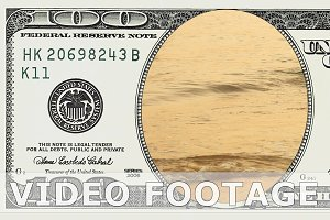 Sea waves sunset in 100 dollar bill