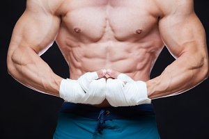 Muscular Fighter kickbox With white