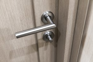 Detail of wooden door. Door handle