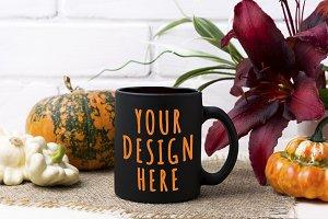 Black coffee mug mockup with pumpkin