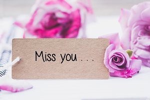 Writing miss you on card