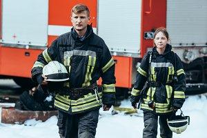 firefighters in fireproof uniform wi