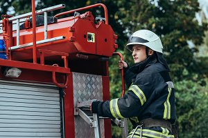 male firefighter in protective helme