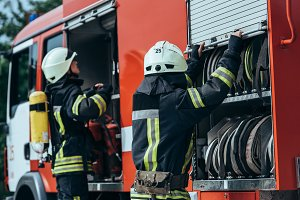 firefighters in protective uniform c