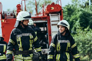 firefighters in protective uniform l