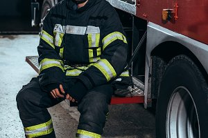 male firefighter in uniform and helm