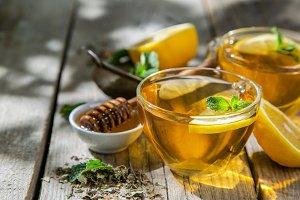 Summer tea - tea cups on rustic wood
