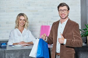 seller and buyer with shopping bags