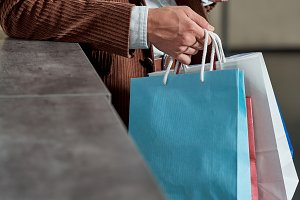 cropped shot of man holding shopping