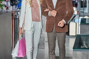 stylish young couple with shopping b