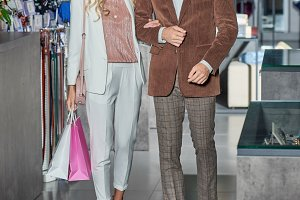 stylish couple with shopping bags sm