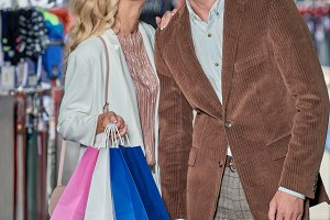 happy woman holding shopping bags an