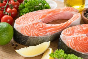 Fresh salmon steaks and ingredients