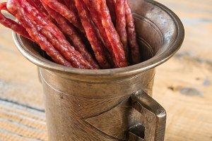 Kabanosy sausages in vintage mug