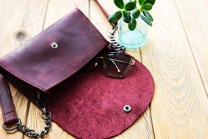 Leather bag and eyeglasses