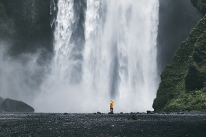 Woman near waterfall in Iceland