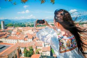 Young caucasian woman making photo o