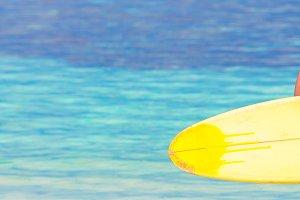 Beautiful fitness surfer woman surfi