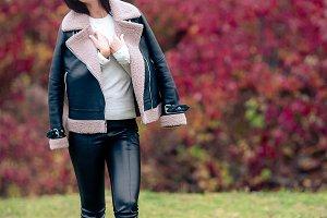 Beautiful girl in autumn park outdoo