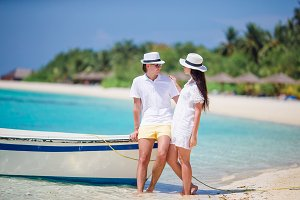 Young happy couple on white beach at