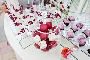 Red and white macarons at wedding ca