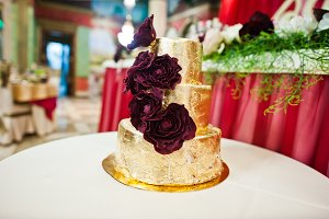 Golden wedding cake with delicious f