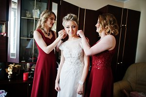 Bridesmaids helped wear bride earrin