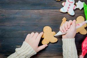 little girl making christmas cookies