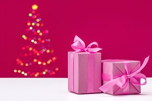 Gifts in pink paper with ribbons.