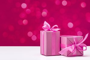 Holiday gifts in pink boxes.