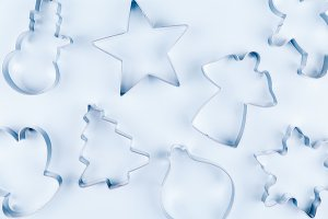 Holiday cookie cutters on blue