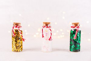 Glass bottles with glitter confetti