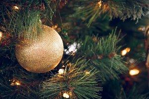 Glitter golden round on Xmas tree