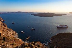 Oia caldera over Aegean sea at sunse