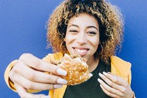 Latin woman eating hamburger togethe