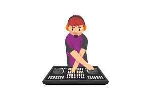 Smiling DJ mixing music on vinyl