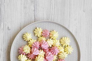 Mini meringues on gray plate