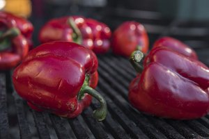 Red sweet peppers cooking on the