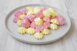 Mini meringues on gray plate